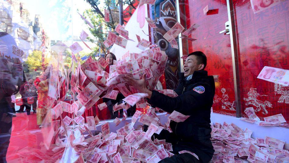 Fang die 100-Yuan-Note: Hedgefonds wollen den Yuan kleinkriegen