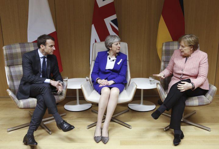 Macron, May, Merkel