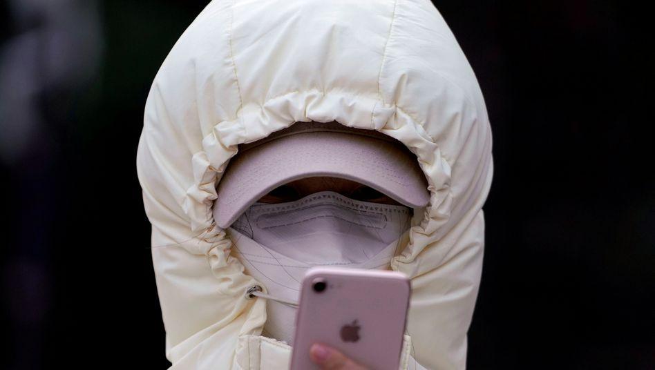 Chinesische Webdienste: Mit dem Smartphone dem Virus ausweichen