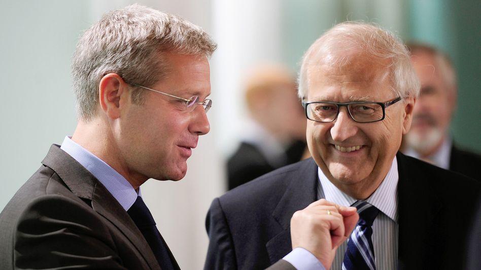 Bundesminister Röttgen (l.), Brüderle: Einigung nach zwölf Stunden