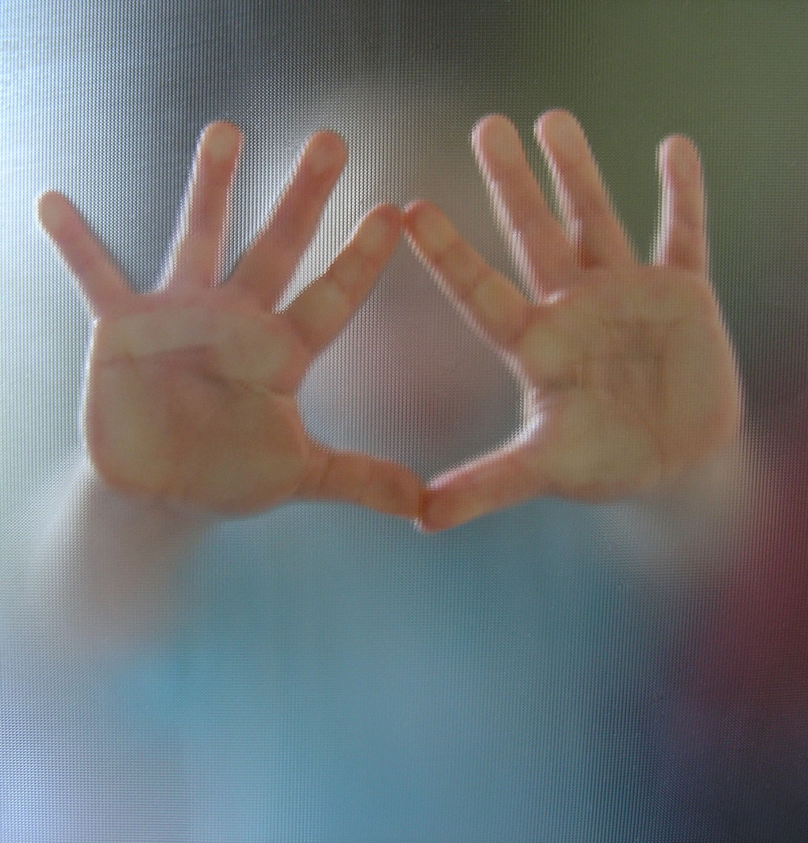 Hands reaching out from a blurred image of a child