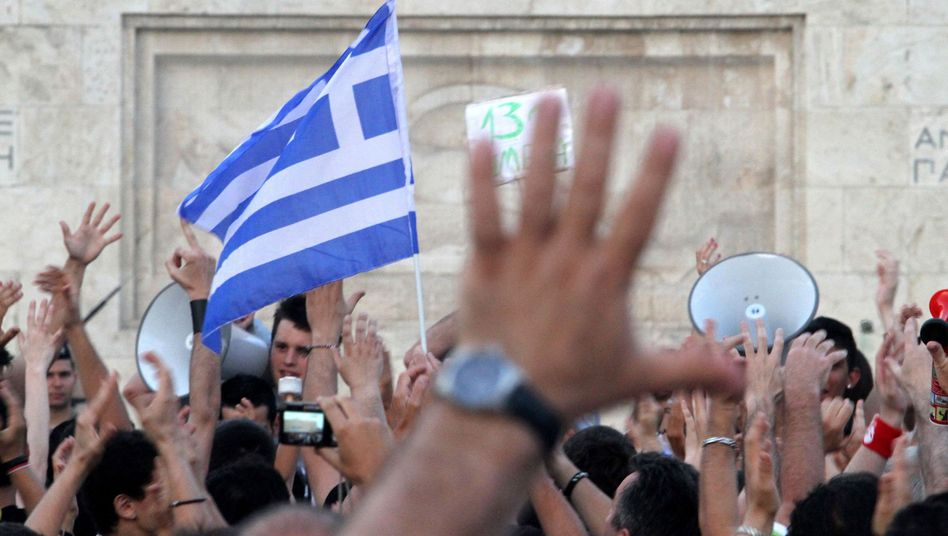 Greek demonstrators protest against the government's planned austerity measures.