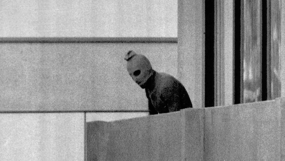 A masked Palestinian terrorist on the balcony of the Israeli athlete quarters at the Olympic Village in Munich in 1972: An explosive report published this week claims terrorists tortured the athletes before killing them.