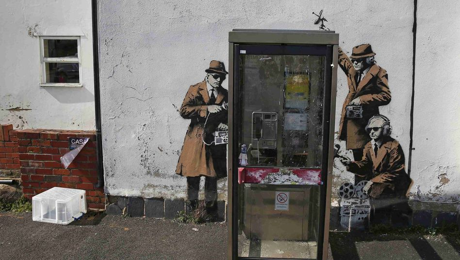 Graffiti art is seen on a wall near the headquarters of the British intelligence agency Government Communications Headquarters (GCHQ) in Cheltenham.