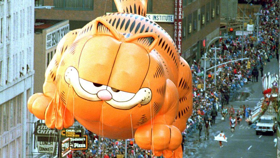 Garfield: Der Prototyp des fetten Katers verdankt seine Leibesfülle seinem nicht sehr felinen Appetit auf Lasagne. Ob da auch Enzyme nachhelfen?