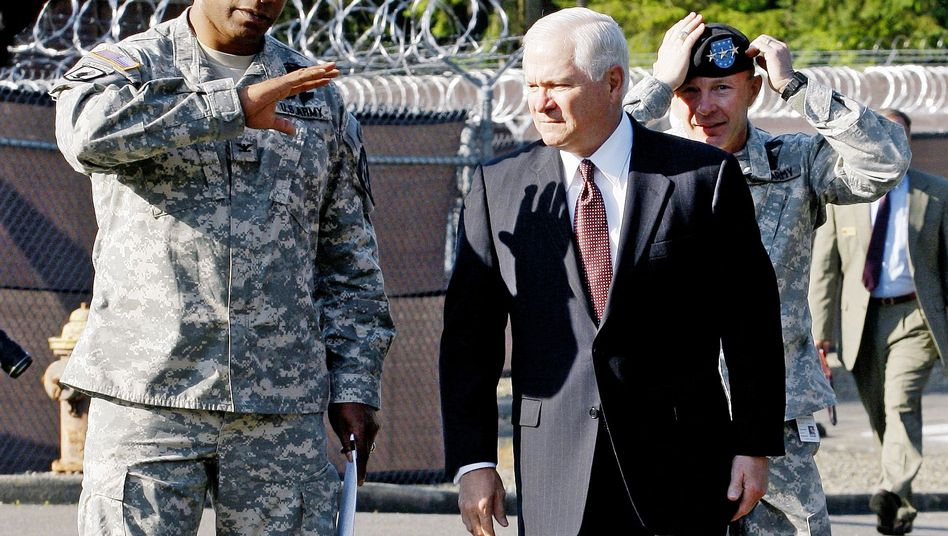 Colonel Harry Tunnell (left) is seen with US Defense Secretary Robert Gates. A secret US Army report paints a damning picture of Tunnell's command in Afghanistan.