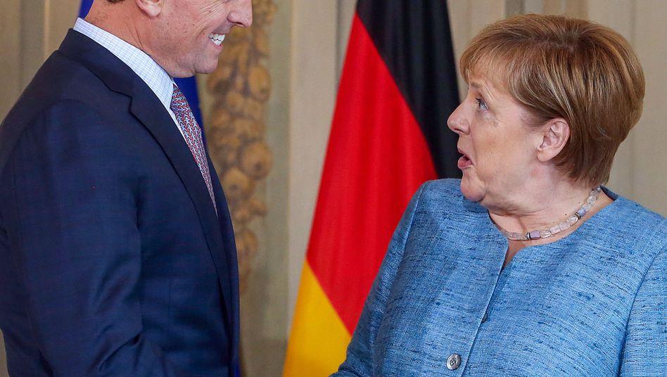 US-Botschafter Richard Ellen Grenell, freundlich, mit Angela Merkel