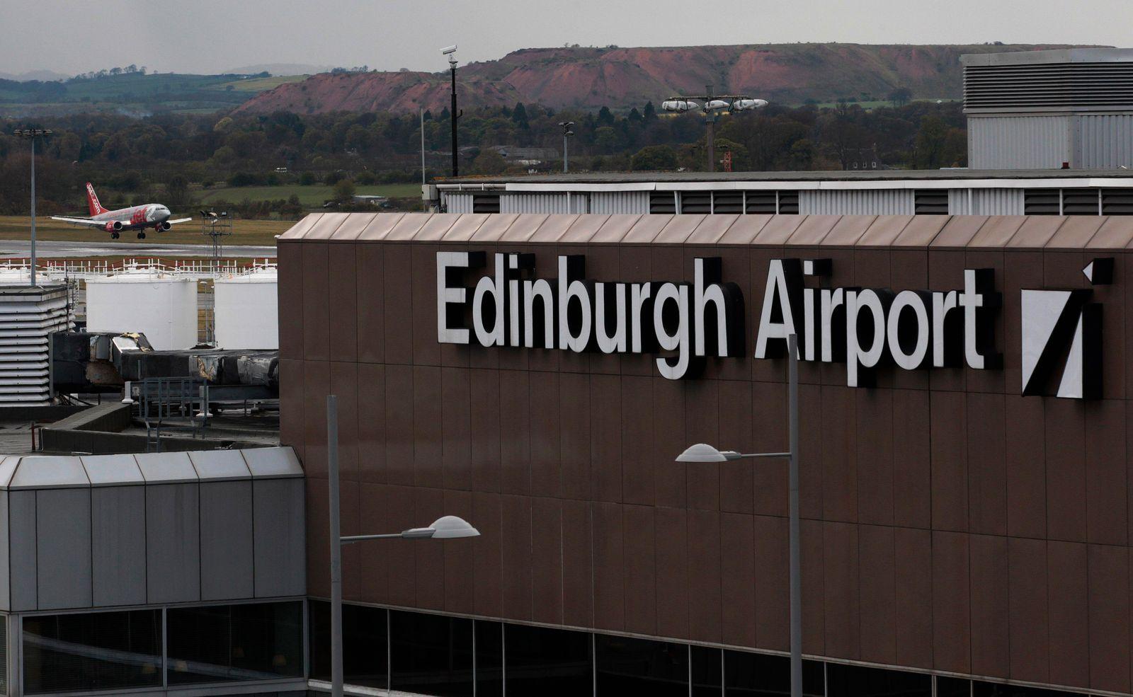 An aircraft lands at Edinburgh Airport in Scotland