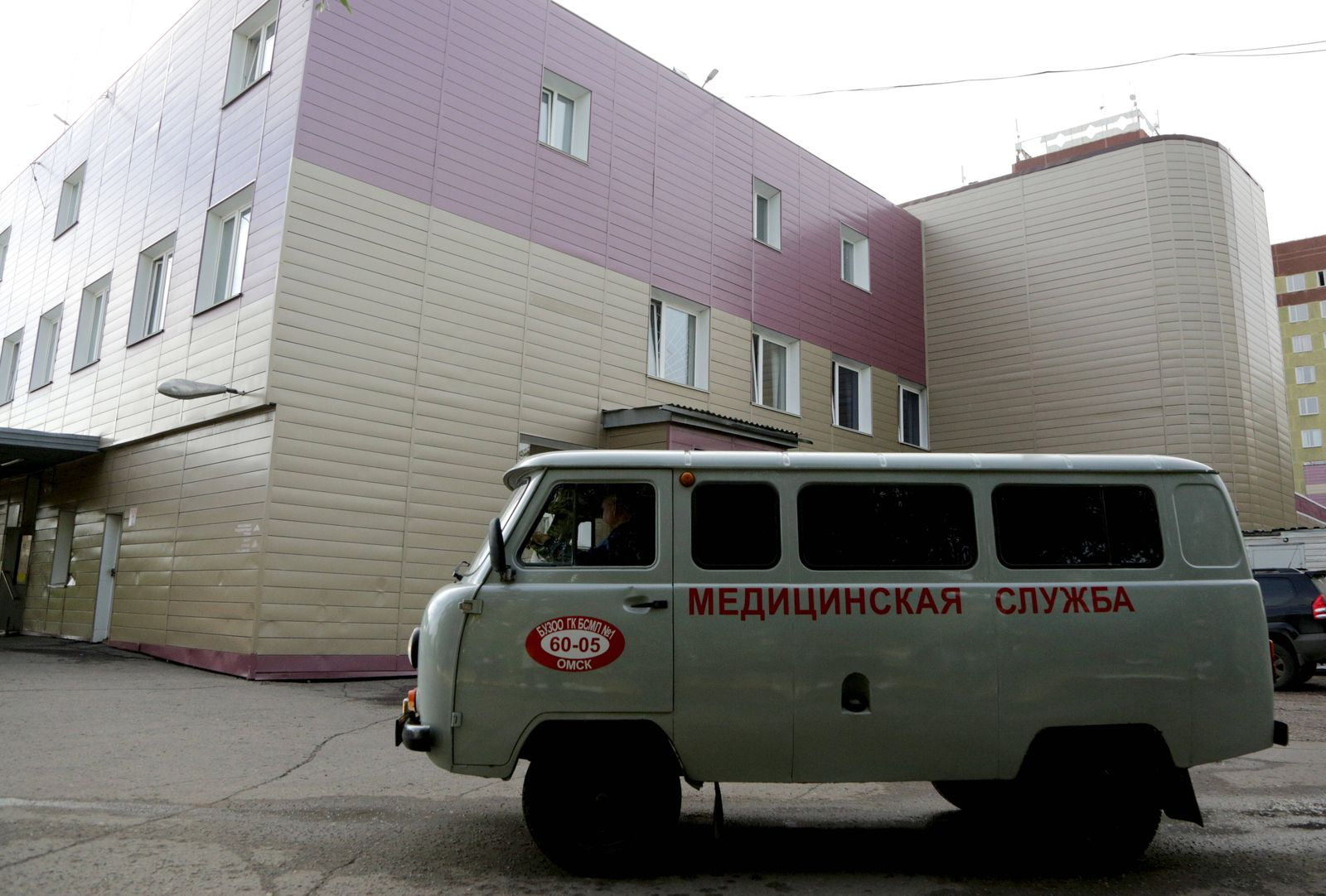 OMSK, RUSSIA - AUGUST 21, 2020: A healthnare service vehicle is parked outside Omsk Ambulance Hospital No 1 where Russi