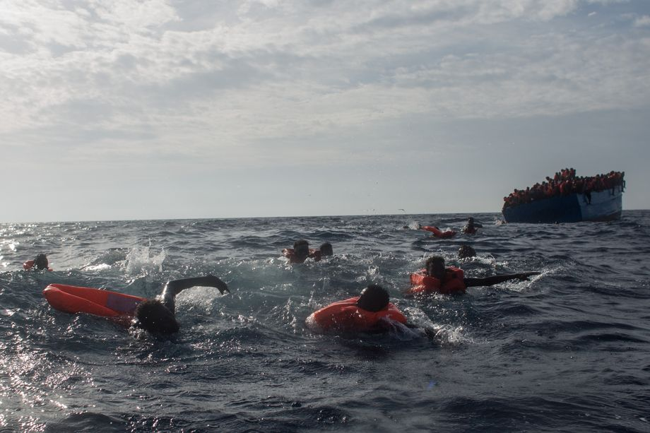 Refugees swimming toward an NGO boat: The central Mediterranean is one of the most dangerous migration routes in the world.