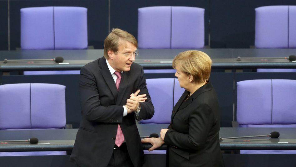 Vertraute Pofalla (l.), Merkel: Wechsel in die Wirtschaft