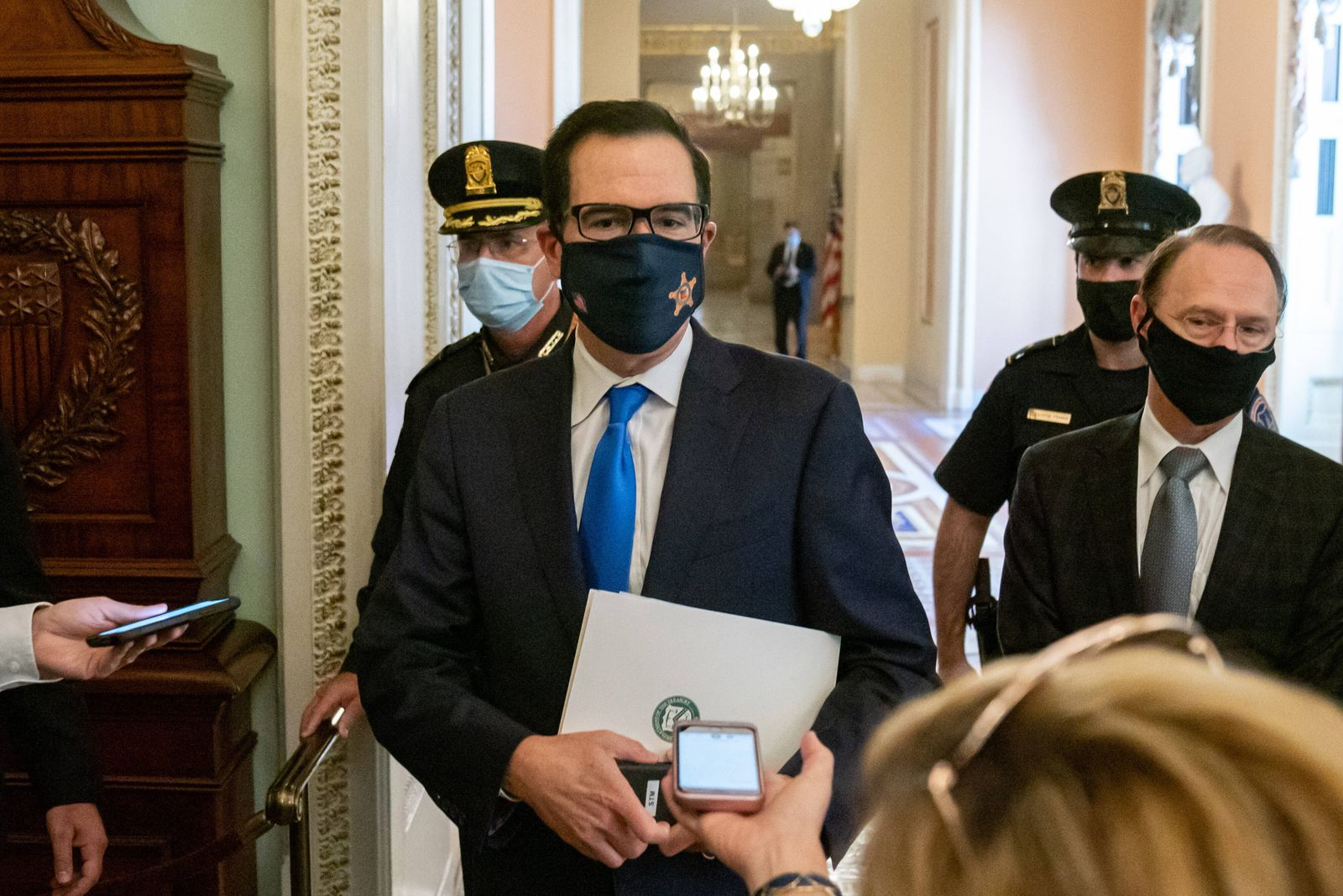 U.S. Treasury Secretary Steven Mnuchin walks from the office of Senate Majority Leader Mitch McConnell (R-KY) at the U.