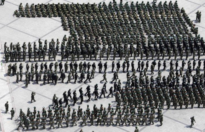 "Chinese security forces get into formation on the People's Square in Urumqi, Xinjiang province: ""We don't want to attack anyone."""