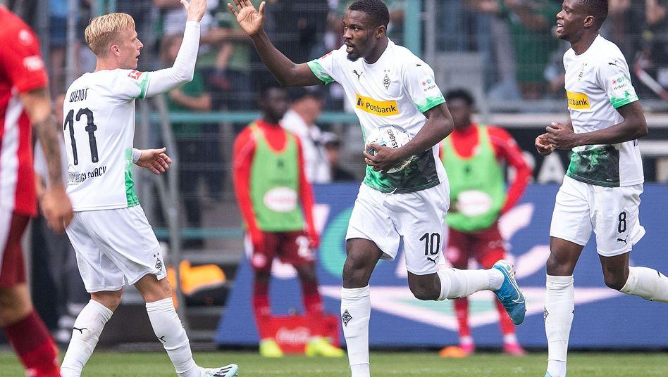 Gladbachs Marcus Thuram (rechts): zwei Treffer in einer Viertelstunde