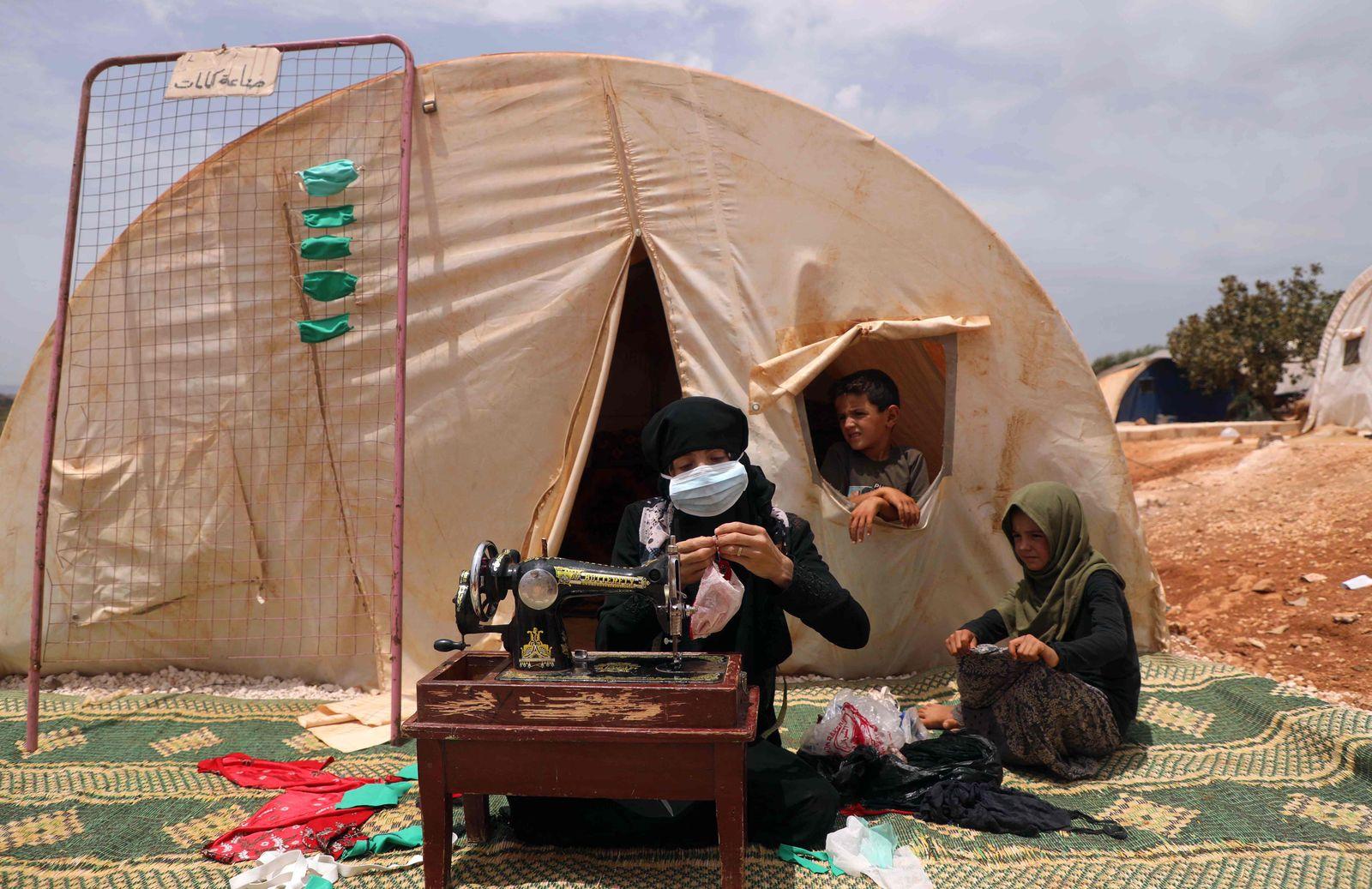 TOPSHOT-SYRIA-CONFLICT-HEALTH-VIRUS