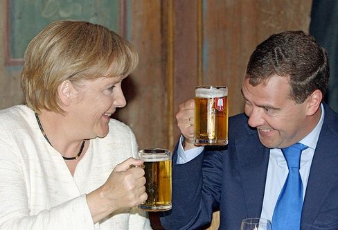 Merkel and Medvedev enjoy a lunchtime beer in Munich on Thursday.