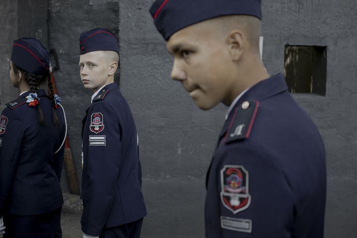 Children in school uniforms in the self-proclaimed People's Republic of Luhansk