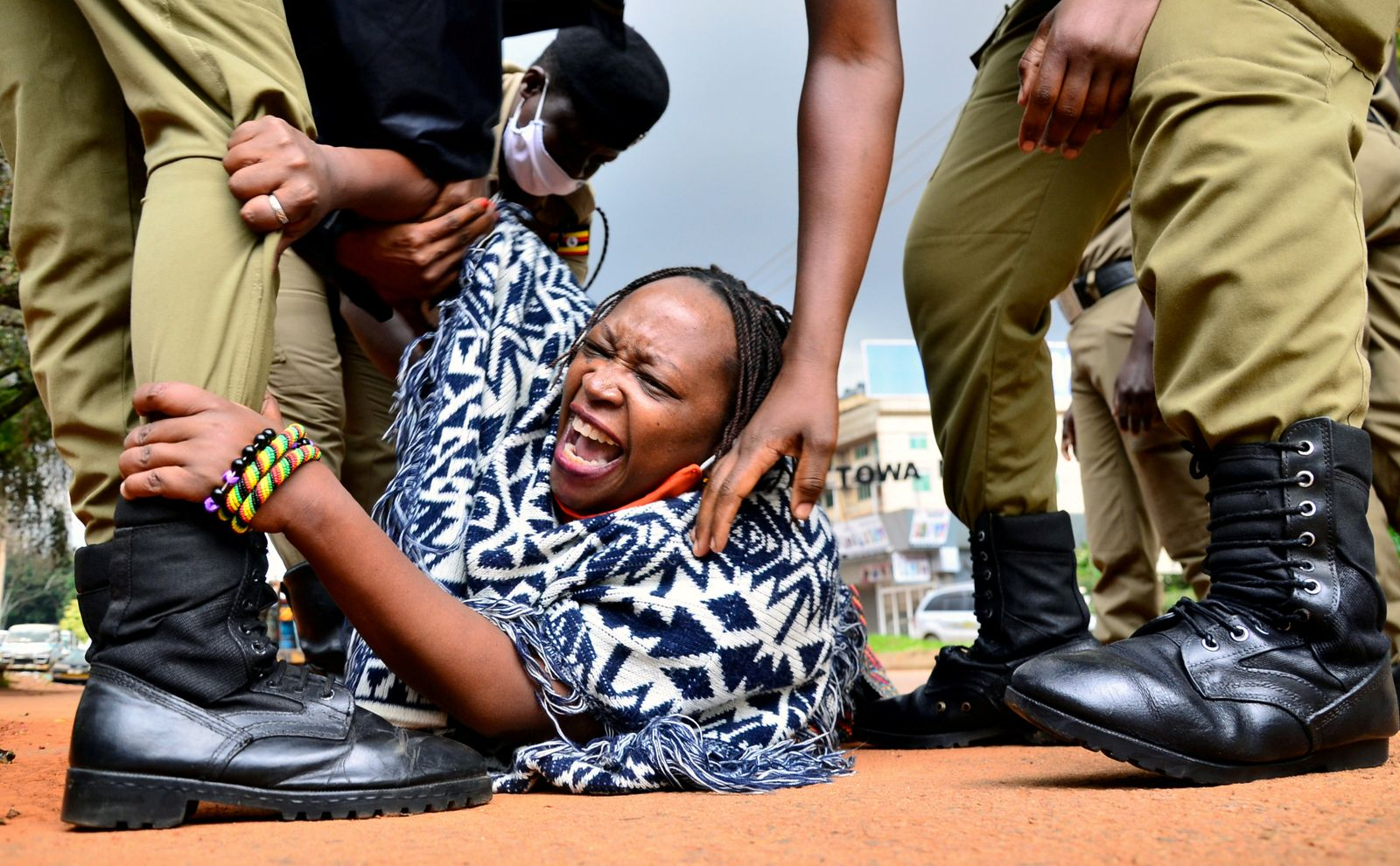Ugandan academic Stella Nyanzi reacts as police officers detain her for protesting against the way that government distributes the relief food and the lockdown situation to control the spread of the coronavirus disease in Kampala