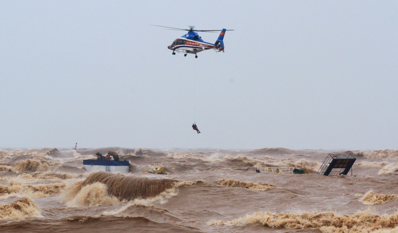 A military helicopter rescues sailors of a submerged ship at Cua Viet Port in Quang Tri province