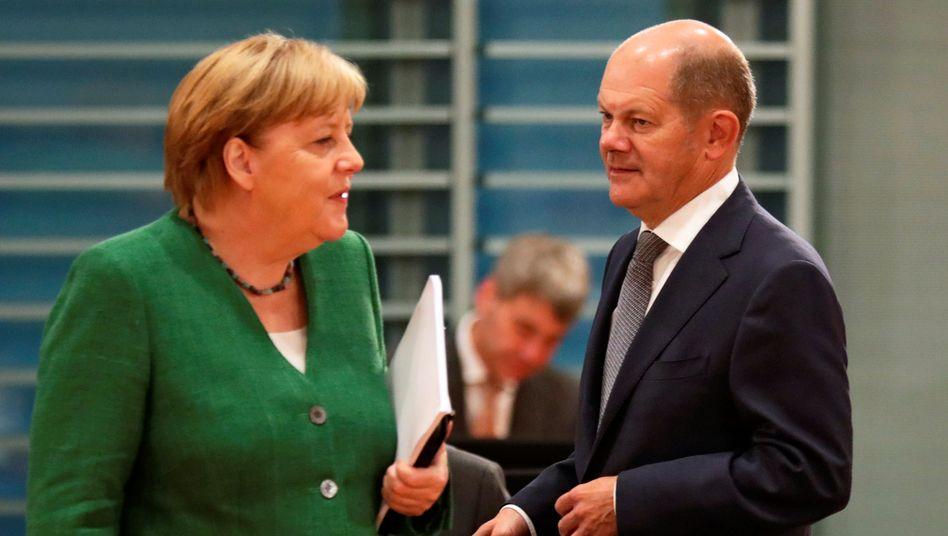 Angela Merkel und Olaf Scholz am Mittwoch bei der Kabinettssitzung im Kanzleramt