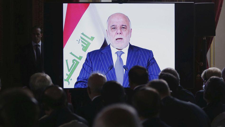 Haider al-Abadi auf einer Videoleinwand
