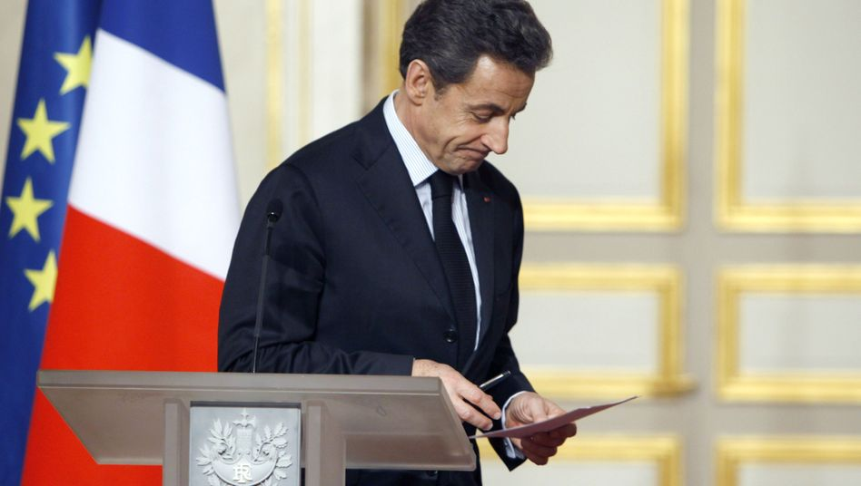 French President Nicolas Sarkozy leaves after a crisis summit with business and labor leaders in Paris on Jan. 18.