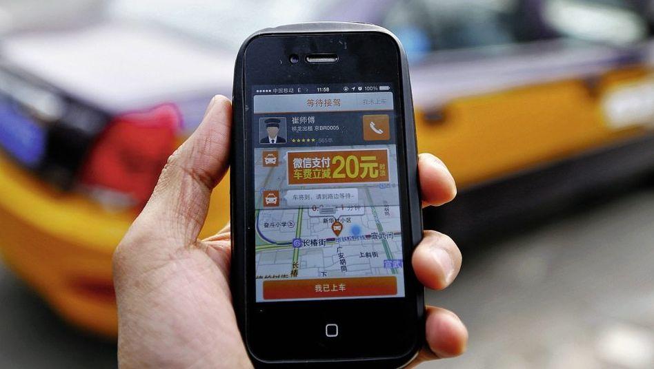 Taxi-App in Peking: Nirgendwo ist mobiles Bezahlen weiter verbreitet als in China