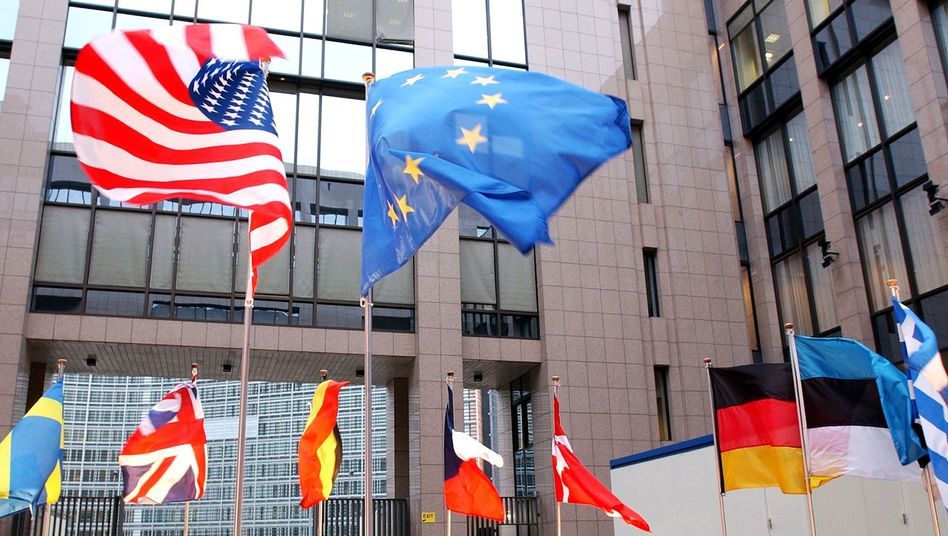 The US and EU flags at the European Council buidling in Brussels. How broad will a free-trade deal be?