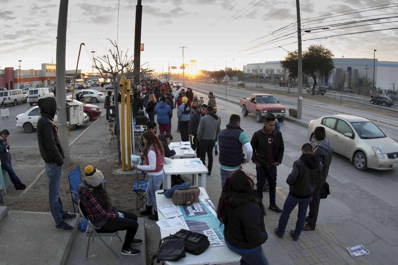 People register for open jobs in a so called bonded factory in Ciudad Juarez Mexico 17 January 201