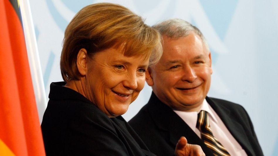 Angela Merkel and Jaroslaw Kaczynski in happier days back in 2006.