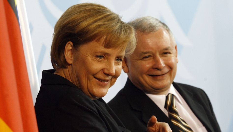 Angela Merkel and Jaroslaw Kaczynski in happier days back in 2006.