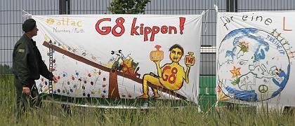 "Plakat gegen G 8 in Heiligendamm: ""Nicht nur Handel liberalisieren"""