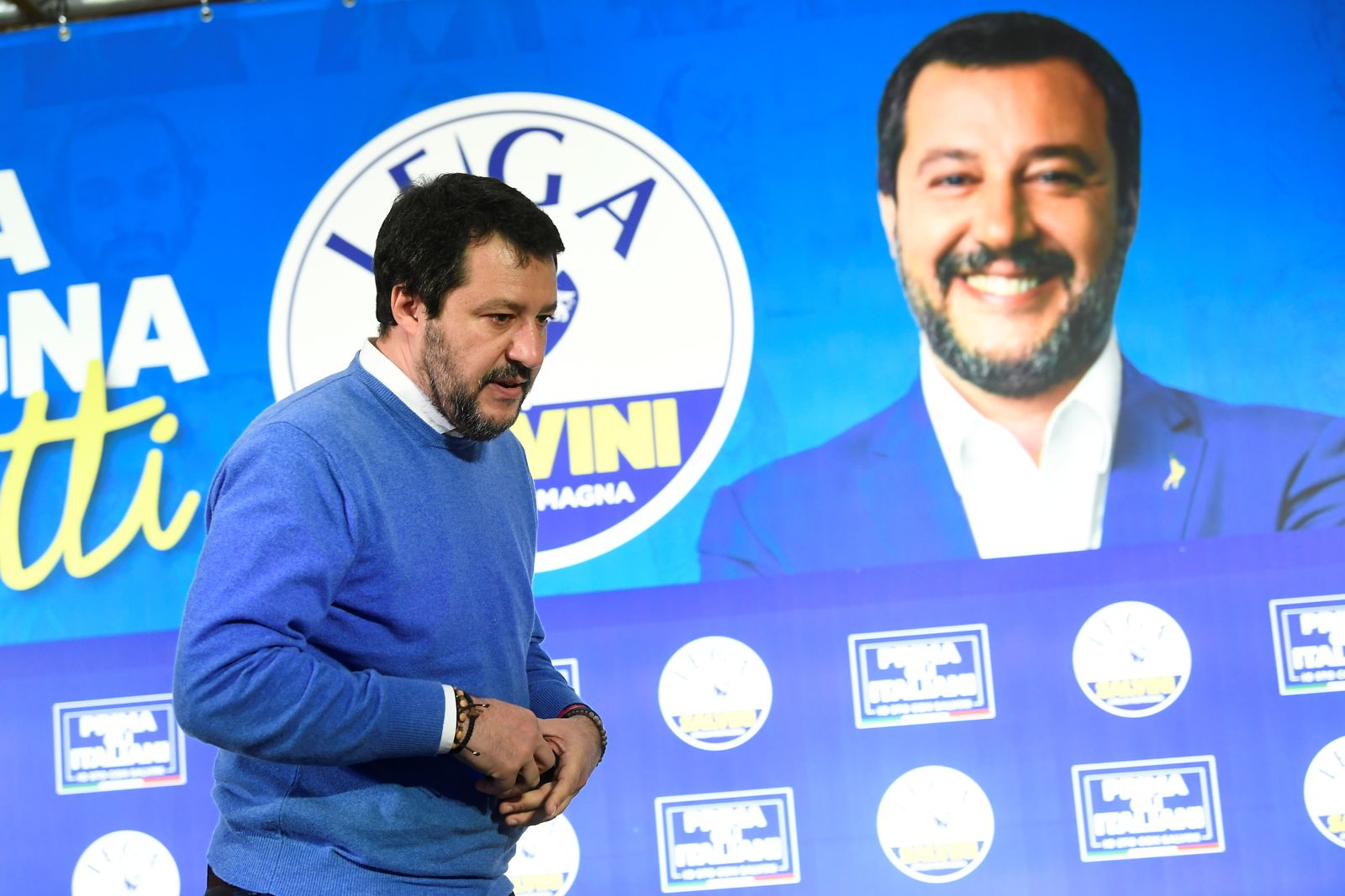 Leader of Italy's far-right League party Matteo Salvini leaves after speaking to the media after polls close for the Emilia-Romagna regional election, in Bologna