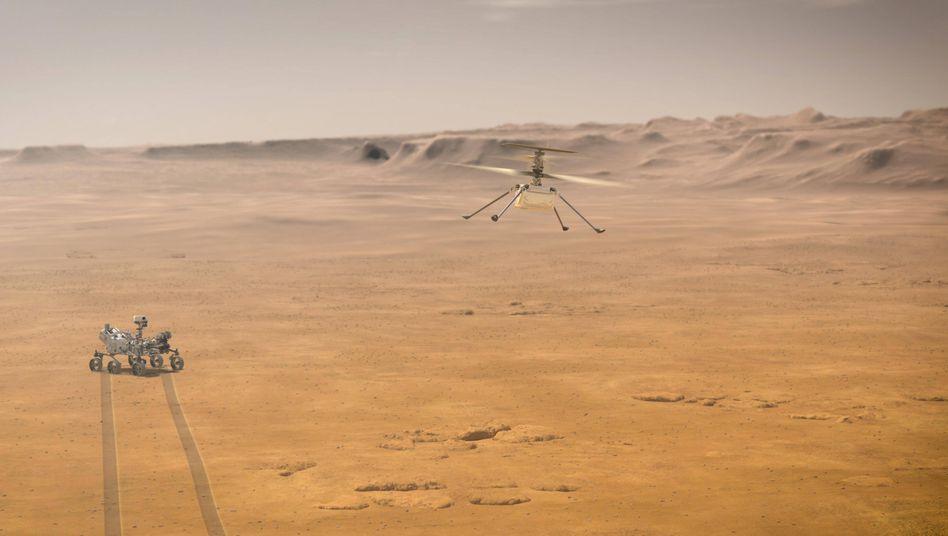 So könnte es aussehen, wenn Nasa-Rover »Perseverance« und Mini-Helikopter »Ingenuity« auf dem Mars unterwegs sind