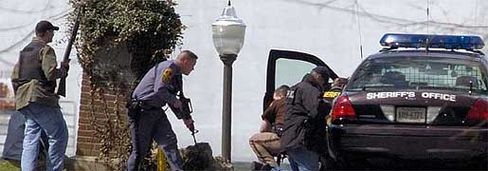 Police attempt to create order in Blacksburg, Virginia, at Virgina Tech University.