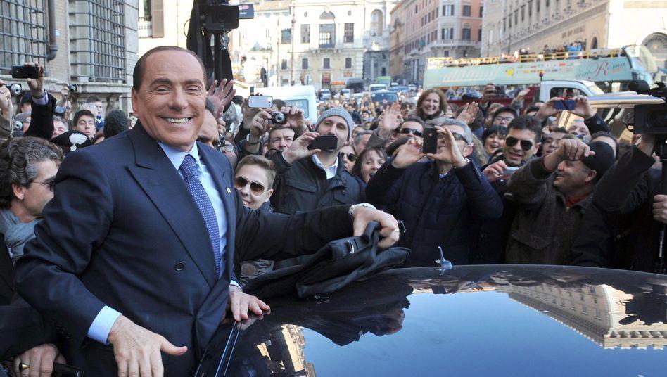 Skandalpolitiker Berlusconi (am Samstag in Rom): Wahlbündnis mit Lega Nord
