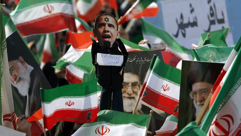 A caricature of US President Barack Obama is held aloft at celebrations marking the 31st anniversary of the 1979 Islamic revolution in Tehran, Iran, in early February.