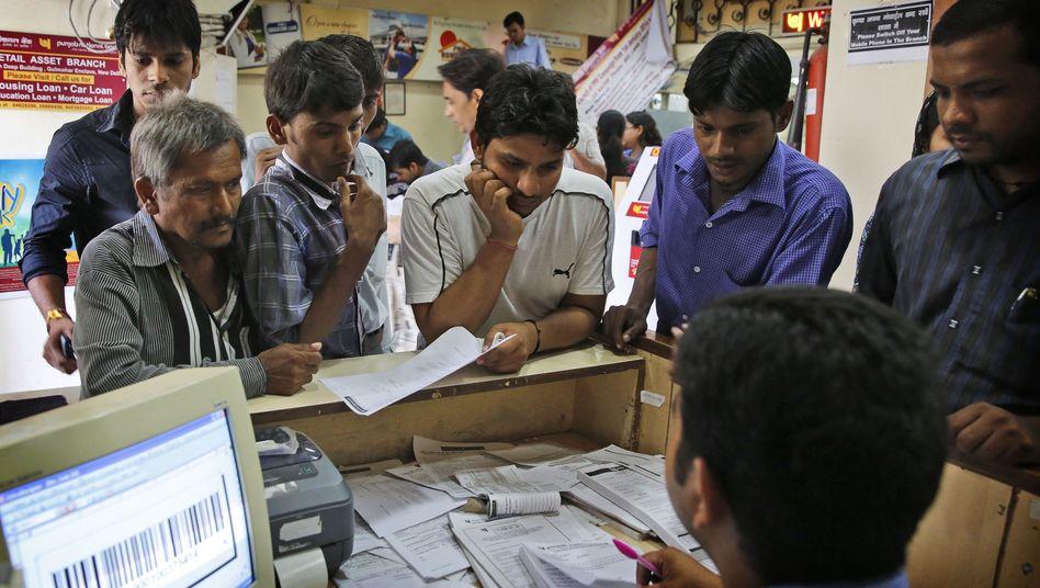 Inder bei der Eröffnung eines Bankkontos in Neu Delhi: Ein Konto für jedermann