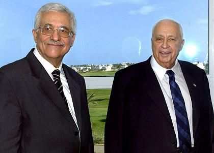 Israeli Prime Minister Ariel Sharon and Palestinian President Mahmoud Abbas at the Middle East summit in Sharm al-Sheik.