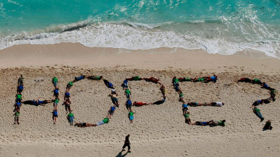 Protestaktion in Cancún: Suche nach dem Kompromiss