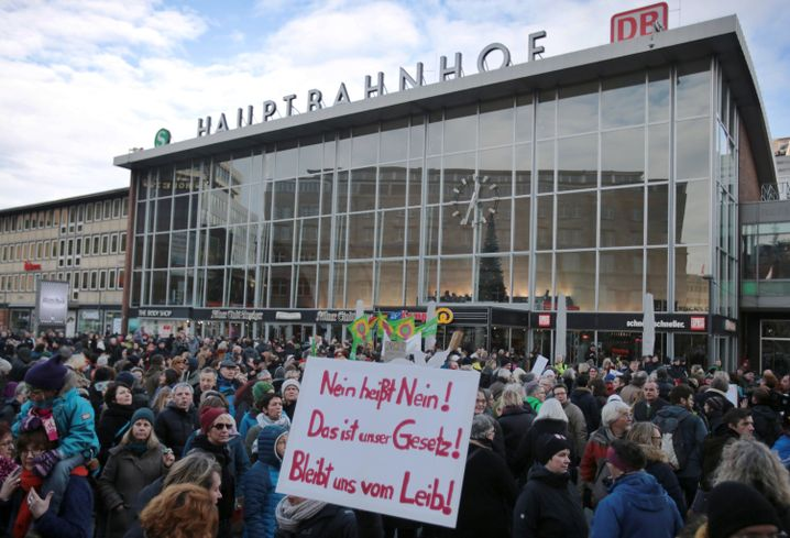 "Protesters stand in front of the Cologne central station, where sexual attacks were perpetrated on a broad scale on New Year's Eve. The sign reads, ""No means no! That's our law. Stay away from our bodies!"""
