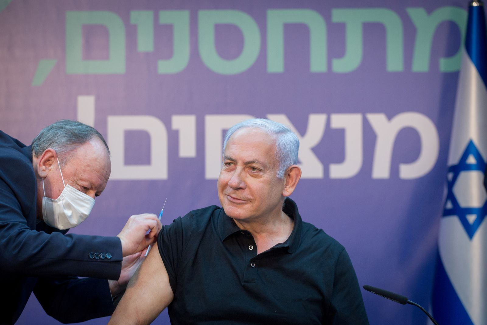 FILE PHOTO: Israeli Prime Minister Minister Benjamin Netanyahu receives the second dose of COVID-19 vaccine
