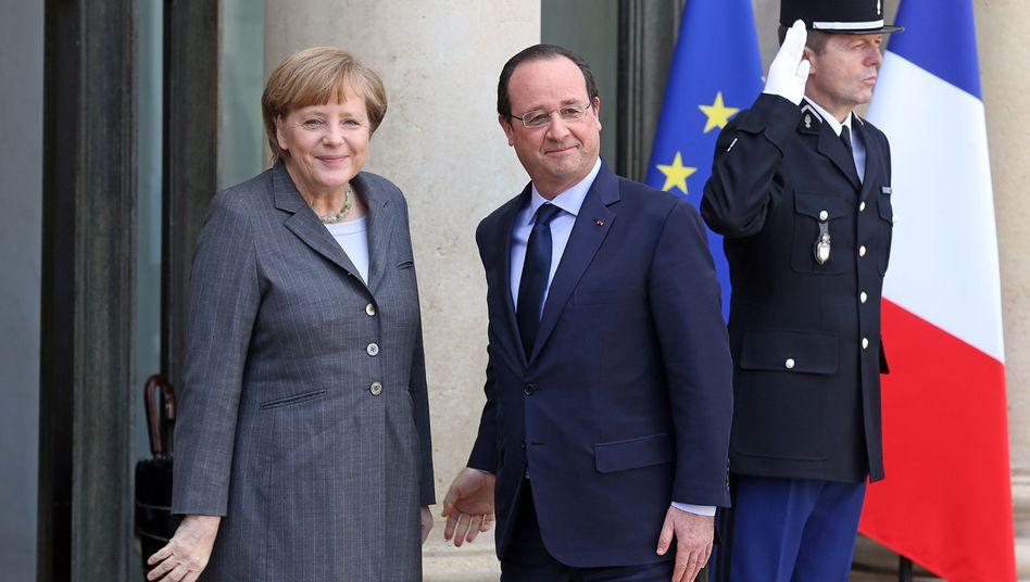 """Merkel bei Hollande in Paris: """"Auch Finanzakteure tragen Verantwortung"""""""