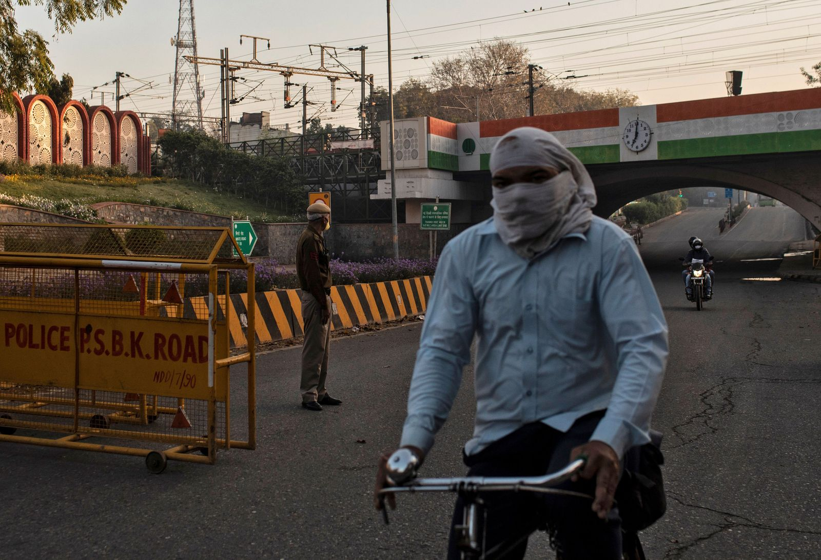 A policeman stands guard next to barricades during 21-day nationwide lockdown to limit the spreading of coronavirus disease, in New Delhi