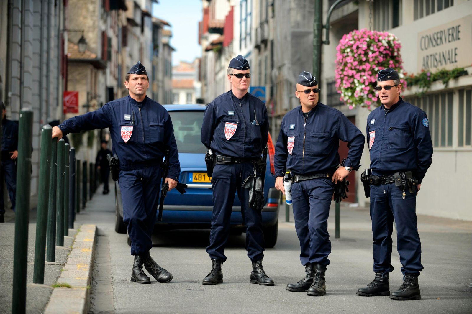French police stand guard outside the headquarters of pro-Basque independence party Batasuna in Bayonne
