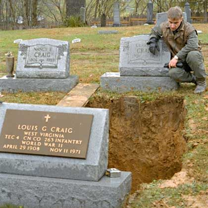 Franz Anthoefer reflects at the grave of the man he believes to be his father. The remains of Louis G. Craig were exhumed for DNA tests to determine conclusively if he was Anthoefer's father.