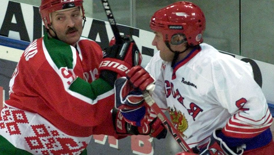 President Alexander Lukashenko's Belarus is being questioned as a host for the world hockey championships in 2014. Here, he is pictured playing ice hockey in a friendly match in Moscow (2001 photo).