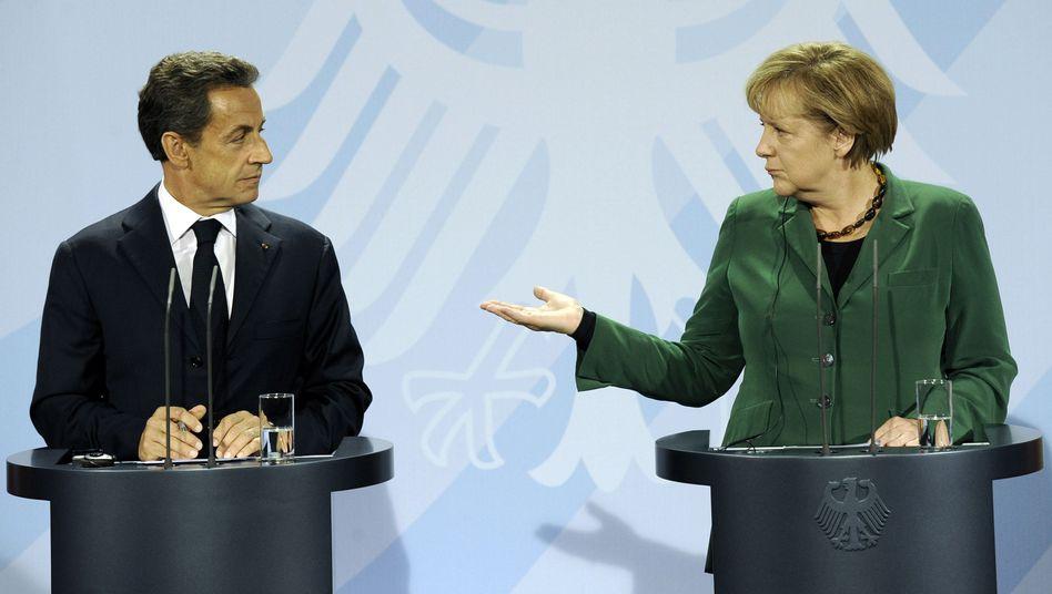 Kanzlerin Merkel, Präsident Sarkozy: Erwartungen an den Gipfel dämpfen