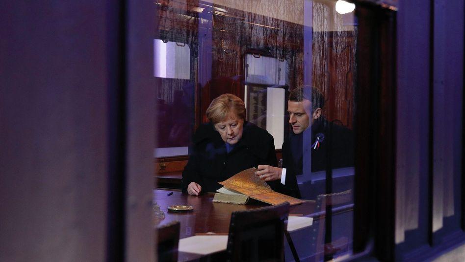 Kanzlerin Merkel, Präsident Macron
