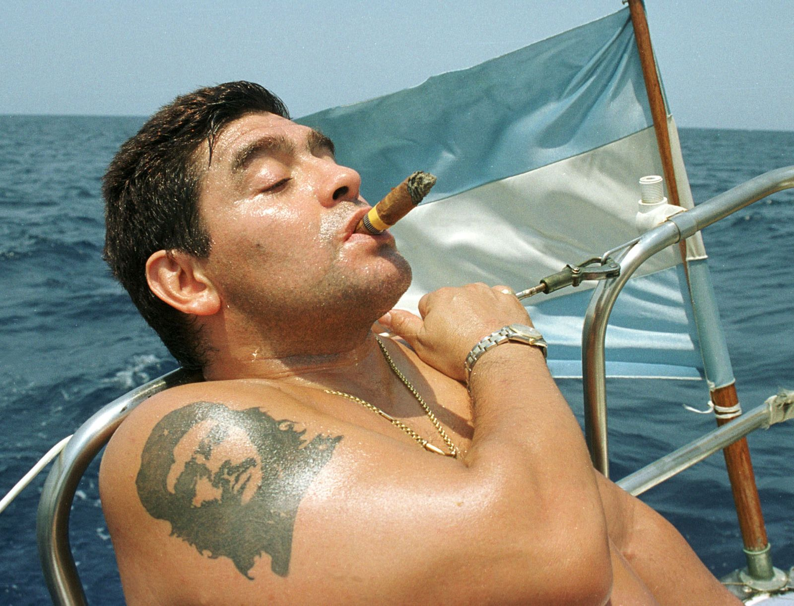 Argentine soccer star Diego Maradona smokes a Cohiba cigar as he rides a sail boat in waters off Hav..